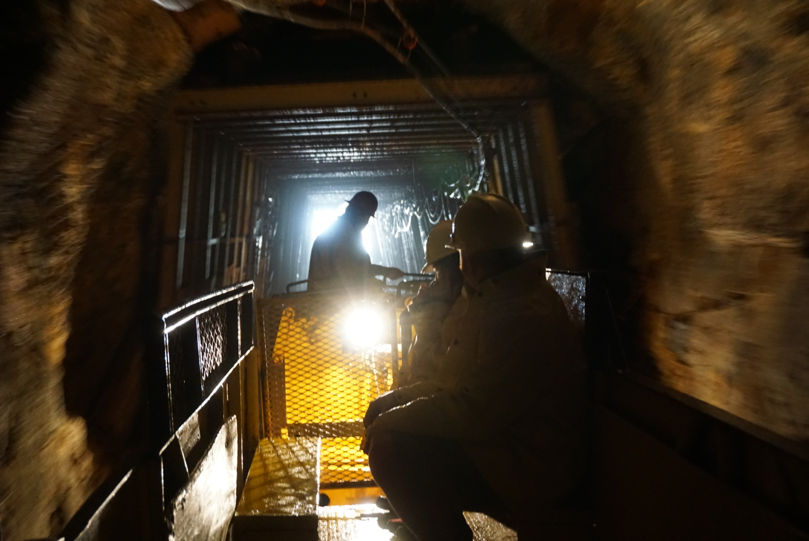 Riding the tram into the mine