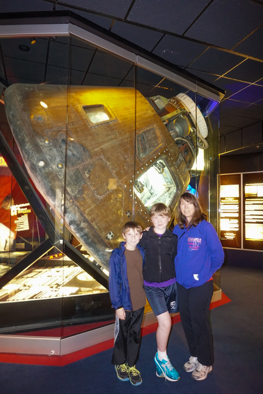 Family with original command module from Apollo 13.