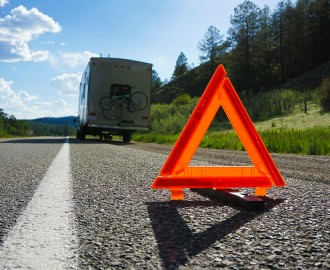 Safety triangle at roadside breakdown site.