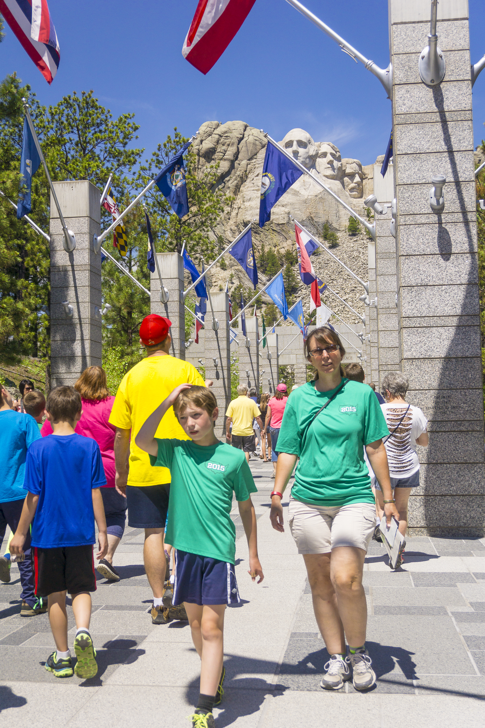 Flags adorning the entryway pillars at Mount Rushmore National Memorial